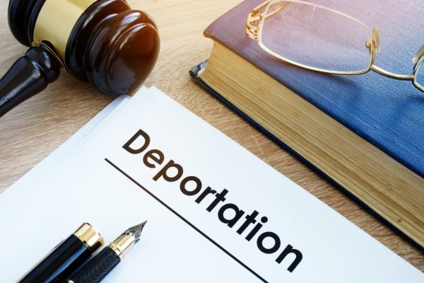 Deportation and other documents on a desk